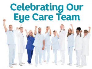 ophthalmic technicians dressed in scrubs with arms raised in celebration