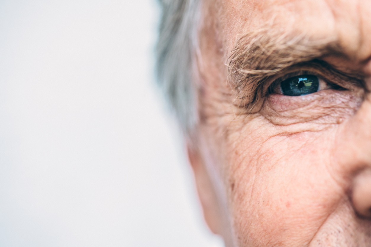 close up of senior caucasian man with blue eyes